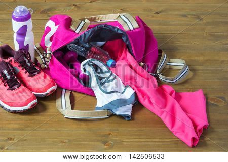 Women's sports bag with stuff inside, On the floor