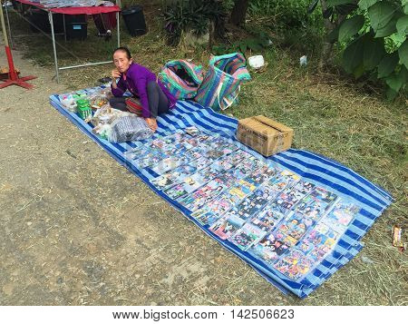 CHIANG RAI THAILAND - AUGUST 9 : horizontal photo of copyright violations of CDs are sold at a market at the Thai-Laos frontier on August 9 2016 in Chiang rai Thailand. This is one of travel attraction in Chiang Rai.