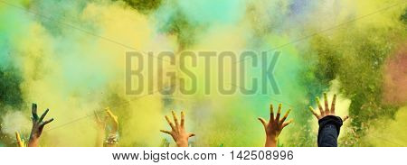 Colorful background. Holi festival with colorful hands