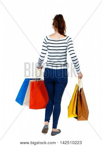 back view of going  woman  with shopping bags . beautiful girl in motion.  backside view of person.  Rear view people collection. Isolated over white background. Girl in a striped sweater went off