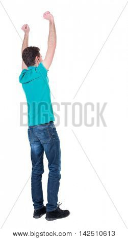 Back view of  man.  Raised his fist up in victory sign.   Rear view people collection.  backside view of person.  Isolated over white background.  Curly man in turquoise blouse standing hands up.
