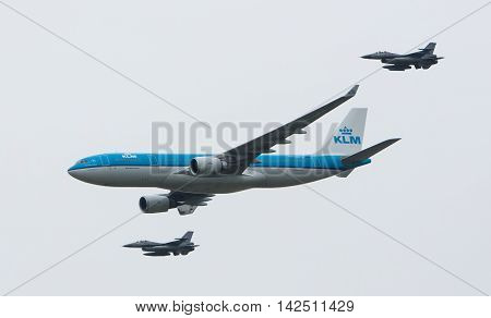 Leeuwarden, Netherlands - June 11 2016: Dutch Klm Boeing Escorted By Two F16 Fighter Jets Of The Dut