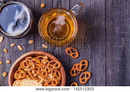 Beer with Pretzels Crackers and Nuts top view.