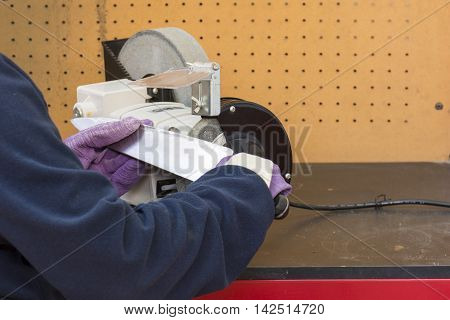 person working, sharpening knife process knife sharpener and hand with blade