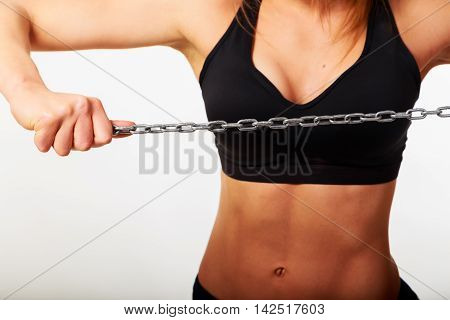Women's fitness and health. Sport girl on a light background.