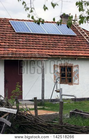 Old antique house with solar panels on the roof