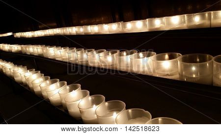 candles in a row to remember the dead and saints