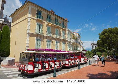 MONACO, MONACO - JULY 17, 2015: Unidentified people enjoy excursion with the sightseeing train in Monaco, Monaco.