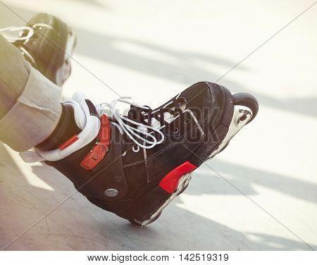 Aggressive Inline Rollerblader Sitting On Ramp In Skatepark