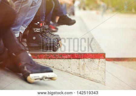 Aggressive Inline Rollerblader Sitting In Outdoor Skate Park
