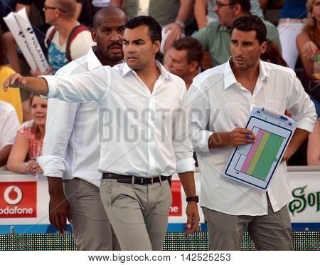 Budapest Hungary - Jul 15 2014. Gabriel HERNANDEZ spanish head coach with his assistant coaches. The Waterpolo European Championship was held in Alfred Hajos Swimming Centre in 2014.