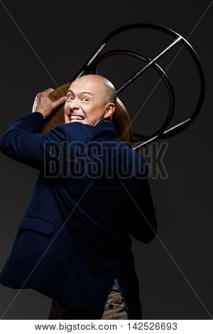 Close up portrait of handsome fury middle-aged businessman over black background. Copy space.