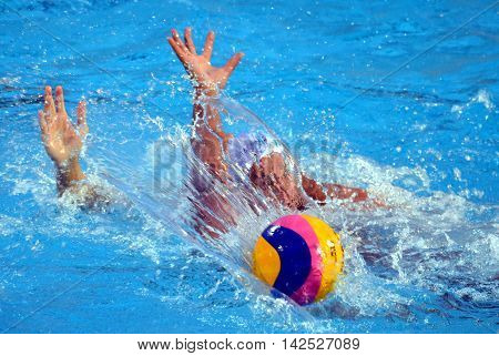 Budapest Hungary - Jul 15 2014. Ball hands and water curtain. The Waterpolo European Championship was held in Alfred Hajos Swimming Centre in 2014.