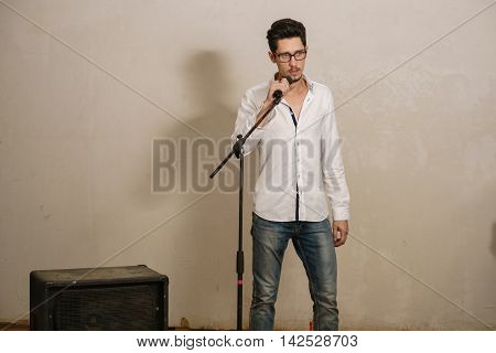 A young vocalist is performing a song