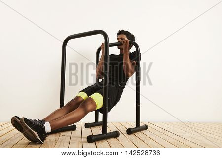 Young Black Athlete Doing Bodyweight Rows On Mobile Bars