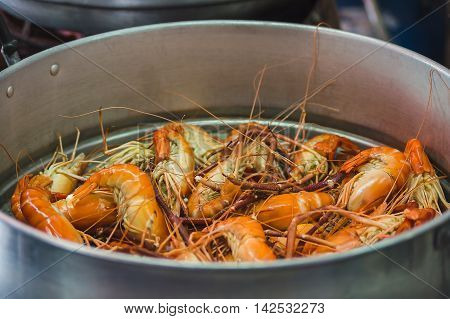 Whole unpeeled Steamed prawns in the steamer