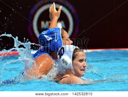 Budapest Hungary - Jul 16 2014. WINSTANLEY-SMITH Angela (GBR 10) and PLEVRITOU Margarita (GRE 4) fighting. The Waterpolo European Championship was held in Alfred Hajos Swimming Centre in 2014.