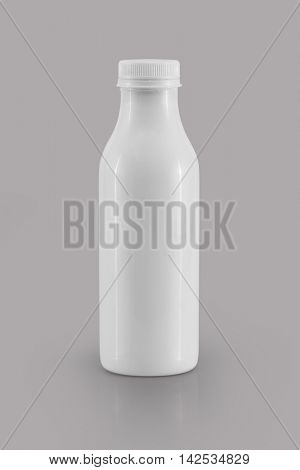 White plastic bottle on gray background. Front view