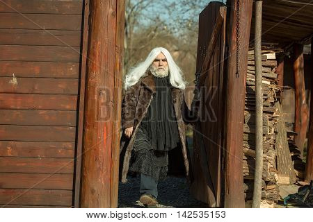 Bearded Man On Wooden Background