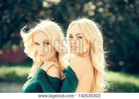 Pretty Blonde Women In Green Dresses