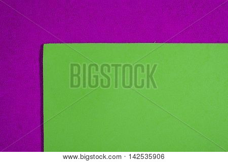 Eva foam ethylene vinyl acetate smooth apple green surface on pink sponge plush background