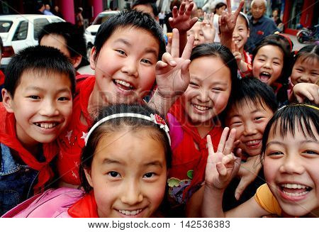 Pengzhou China - May 16 2007: Happy Chinese school children on Li Ren Jie