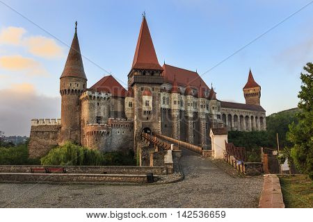 View on transylvanian Corvin castle in sunrise