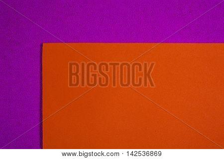 Eva foam ethylene vinyl acetate smooth orange surface on pink sponge plush background