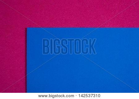 Eva foam ethylene vinyl acetate smooth blue surface on pink sponge plush background