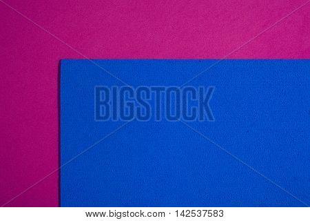 Eva foam ethylene vinyl acetate sponge plush blue surface on pink smooth background