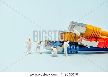 Technicians with multicolored network cables. Macro photo