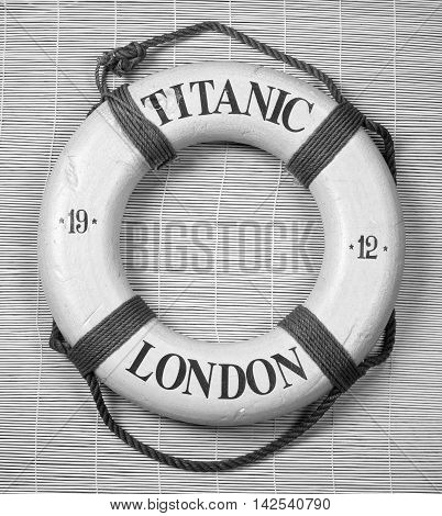Titanic lifesaver with date of 1912 and London on it in black and white.