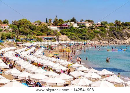 PAPHOS CYPRUS - JULY 24 2016: Coral Bay Beach one of the best sandy beaches located near Pegeia village