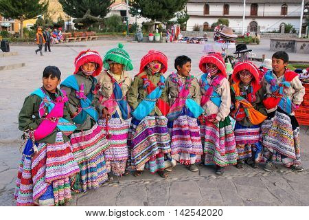 Yanque, Peru-january 16: Unidentified Boys In Traditional Costumes Stand At The Main Square On Janua