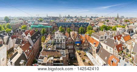 Panorama of residential areas. Aerial view. Amsterdam from above, apartment buildings, historic houses of the old city quarter, Holland, Netherlands.