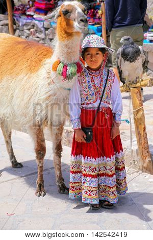 Maca, Peru-january 16: Unidentified Girl In Traditional Dress Stands At The Market On January 16, 20