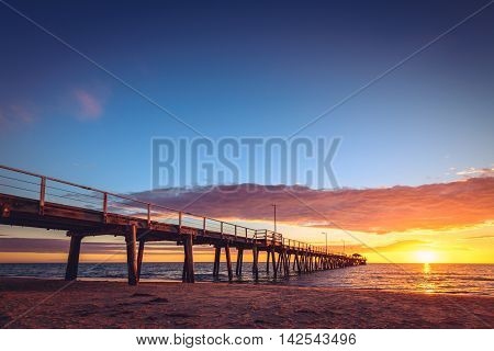 Henley Beach Jetty at sunset South Australia. Color-tining applied
