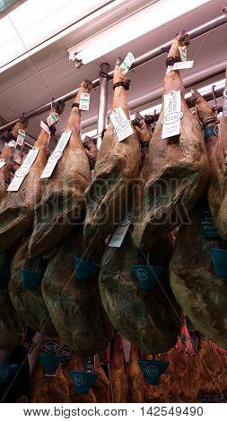 Valencia, Spain - June 20, 2016: Spanish hams for sale at Mercado Central, Valencia, Spain