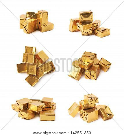 Pile of multiple bouillon stock broth cubes wrapped in golden foil, composition isolated over the white background, set of six different foreshortenings