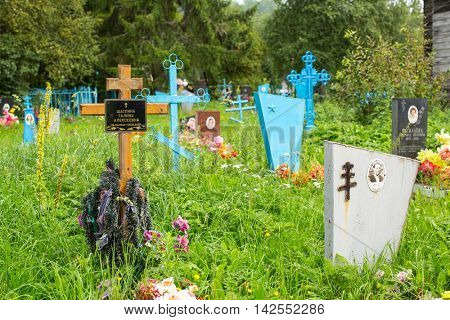 SOGINICY, RUSSIA - JUL 30, 2016: Cemetery on site of Church of Nichola. Church of St. Nicholas at Soginicy, the only surviving sample of a steepled Church prionezhskiy school, 1696 built.