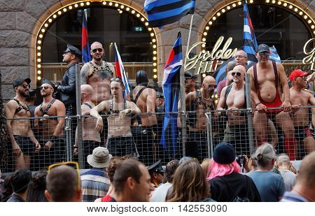 STOCKHOLM SWEDEN - JUL 30 2016: Group of macho men dressed in leather wearing sunglasses standing on a truck bed in the Pride parade July 30 2016 in Stockholm Sweden