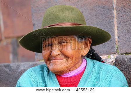Cusco, Peru - January 20: Unidentified Woman (portrait) Sits In The Street On January 20, 2015  In C