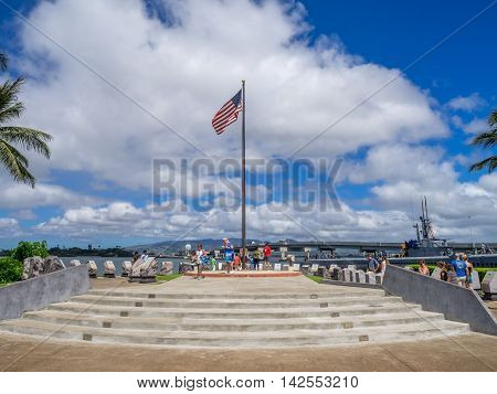OAHU, HI - AUG 5, 2016: Tourists taking in the experience at the Pearl Harbor museum on August 5, 2016 in Oahu. Attack on Pearl Harbor by Japan in 1941 brought United States into World War II.