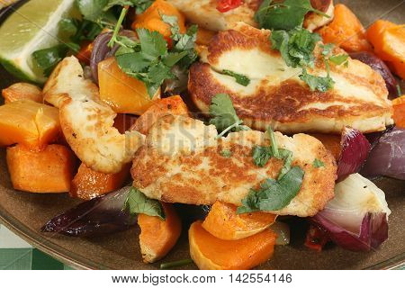 grilled halloumi cheese with roast sweet potato and red onion