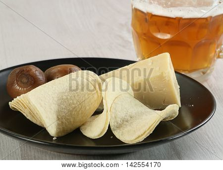stack of potato chips with cheese pickled onion and beer