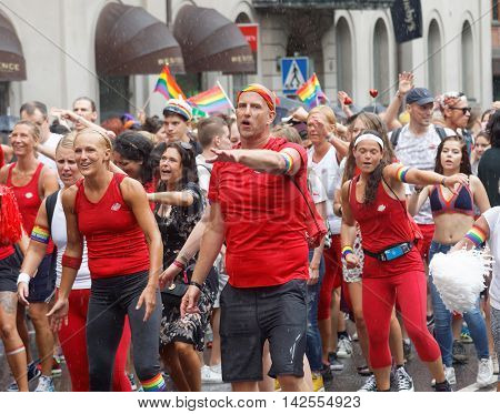STOCKHOLM SWEDEN - JUL 30 2016: Group of dancing people from the Friskis & Svettis organisation in the Pride parade July 30 2016 in Stockholm Sweden