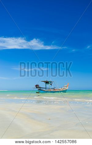 Thai longtail boat and beautiful beach