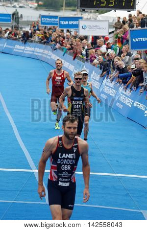 STOCKHOLM - JUL 02 2016: Running triathlete Bowden Buchholz and Salvisberg at the finish in the Men's ITU World Triathlon series event July 02 2016 in Stockholm Sweden