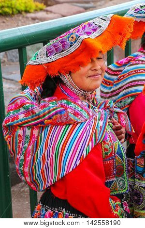 Cusco, Peru - January 20: Unidentified Woman In Traditional Dress Stands In The Street On January 20