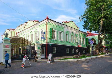 UGLICH RUSSIA - JULY 19 2016: Unidentified people walk on street Olga Bergholz near cafe